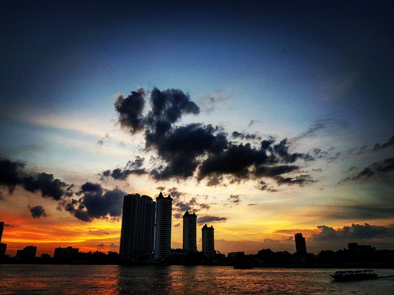 sunset, sky, architecture, built structure, building exterior, cloud - sky, silhouette, skyscraper, urban skyline, water, sea, outdoors, cityscape, scenics, no people, nature, city, beauty in nature, modern, day
