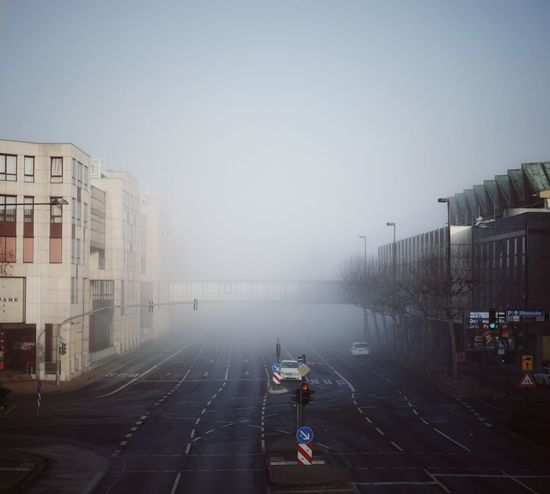 Foggy mornings in Mainz... Foggy Winter Urbanliving Colour Your Horizn Fog Wet Street City Road People Outdoors Day Sky #urbanana: The Urban Playground