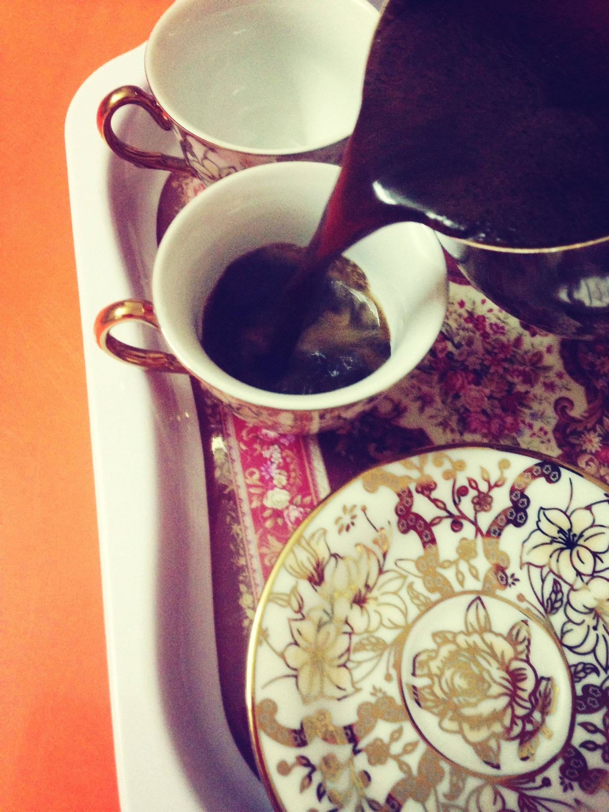 food and drink, drink, indoors, coffee cup, table, refreshment, freshness, coffee - drink, saucer, spoon, cup, coffee, still life, high angle view, tea cup, healthy eating, close-up, bowl, breakfast, frothy drink