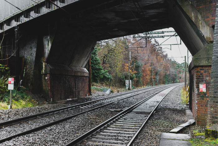 Train tracks at a train station just outside of Manchester, UK. Nature Train Tracks United Kingdom Architecture Bridge - Man Made Structure Built Structure Connection Day Nature Nature And City No People Outdoors Rail Rail Transportation Railroad Railroad Track Railway Track The Way Forward Track Tracks Train Train Station Trainline Transportation Uk