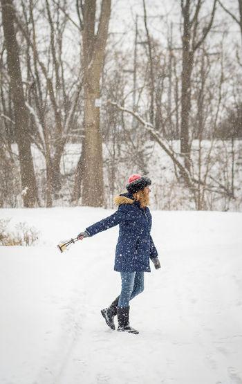 Full length of child on snow covered landscape