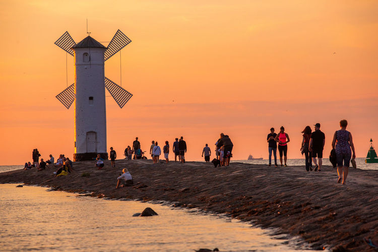 Baltic Sea Stawa Mlyny Architecture Beach Crowd Group Of People Horizon Over Water Land Large Group Of People Leisure Activity Lifestyles Men Nature Orange Color Outdoors Real People Sand Scenics - Nature Sea Sky Sunset Water Women