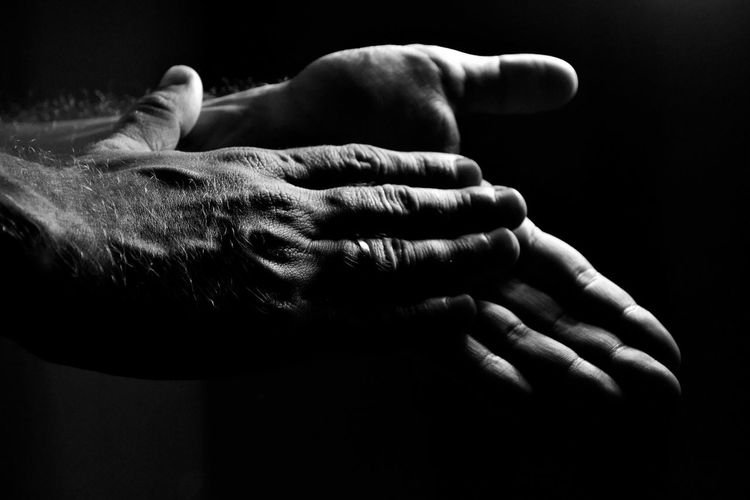 Low Light Black And White Black Background Bonding Clapping Hands Clapping With Excitement Enjoy The Moment Hand Gestures Human Hand Indoors  Mystery Real People Togetherness Touching Moments