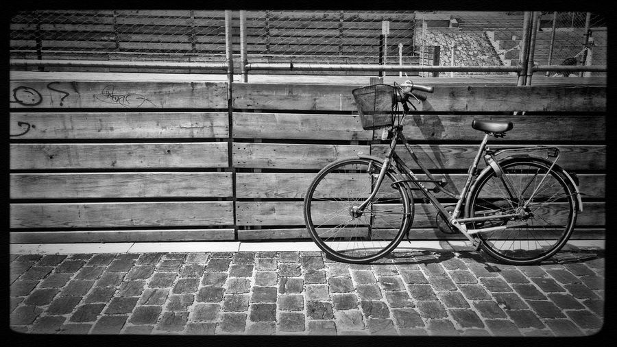 Bicycle parked on wall