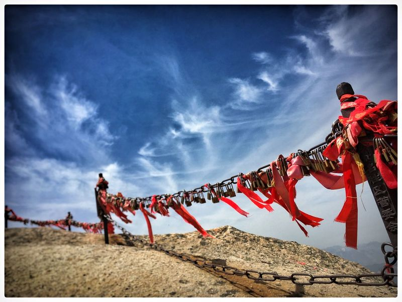 Blue Chinese Culture Chinese Tradition Cloud - Sky Cloud Shapes  Cloudy Contrast Culture Day Huashan Mountain Locks Locks Of Love Mountain Top Mountain View No People Outdoors Red Red Cloth Rock Sky Wind