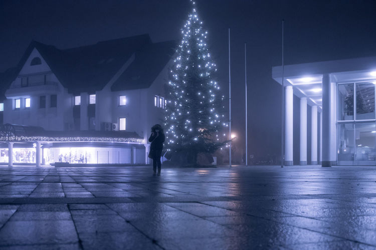Alone with a tree Architecture Bright Building Exterior Built Structure Celebration Christmas Christmas Decoration Christmas Lights Christmas Market Christmas Tree City Ground Level View Illuminated Midnight Modern Night Outdoors People Sky Travel Destinations Tree