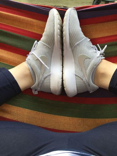 Casual Clothing Fashion Hammock Human Leg Leisure Activity Lifestyles Low Section Real People Shoe Sneakers Women Young Adult Young Women