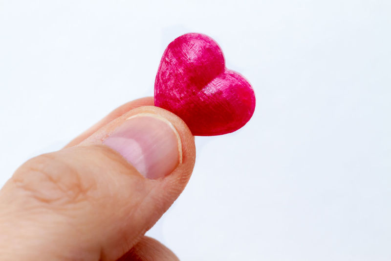 Little heart Hand Finger Red Holding Love Heart Healthy Eating Empathy Help Health Care Symbol Valentine's Day  Valentine Emotion Close-up Card Greetings Wedding Marriage  Anniversary Gift Romance Happy Care Candy