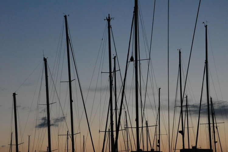 Low angle view of sailboats against sky