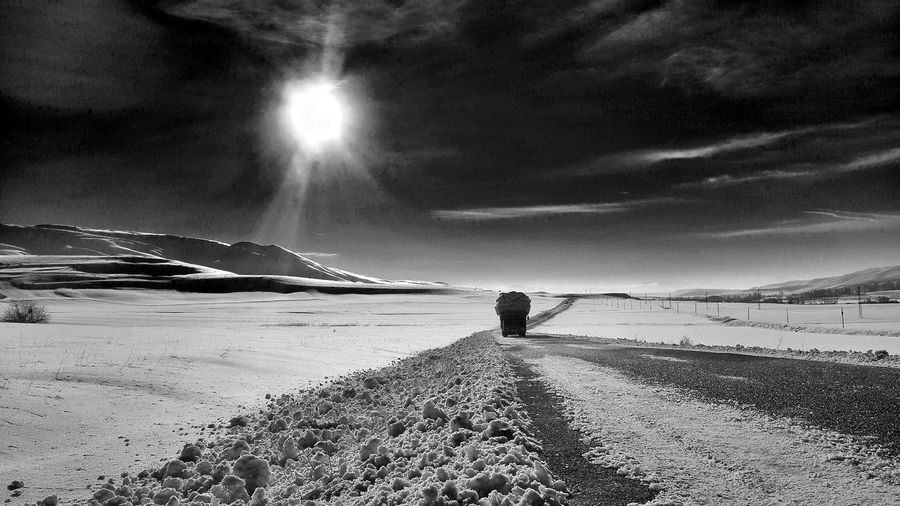Over Burdened Truck By Snow Covered Field