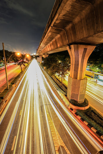 Architecture Bridge - Man Made Structure Built Structure City High Street Highway Illuminated Light Trail Long Exposure Motion Night No People Outdoors Road Sky Speed Street Street Light Traffic Transportation