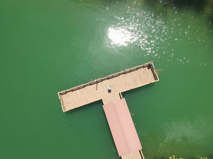 Aerial view of structure in lake