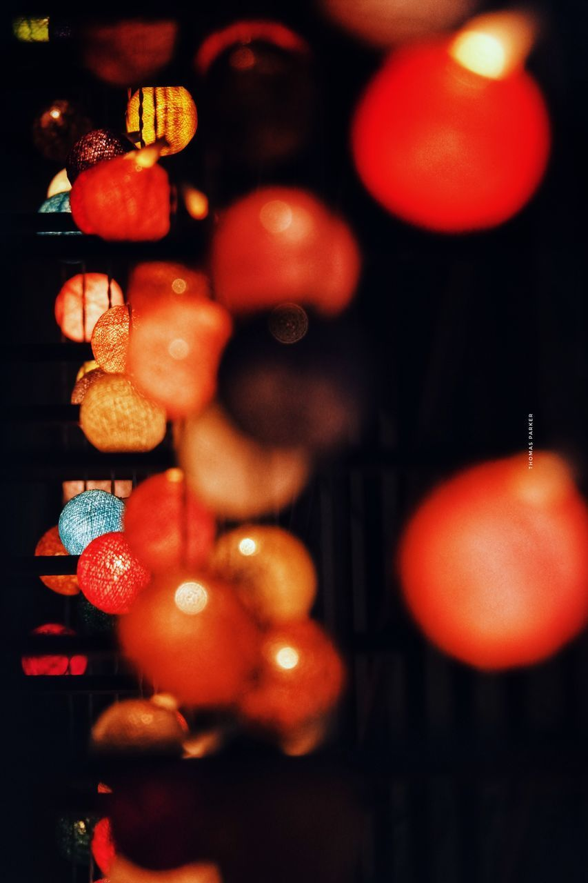 CLOSE-UP OF CHRISTMAS LIGHTS HANGING ON STREET