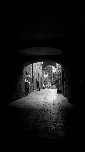 Walking alone. darkness and light Darkness And Beauty The Art Of Street Photography Streetphotography_bw Full Frame Blackwhite Black&white Black & White Black And White Blackandwhite Bnwphotography Shadow Photography Italy Full Frame Vertical Photography One Person Streetphoto_bw Blancoynegro Shadow And Light Cinematic Full Length Architecture Archway