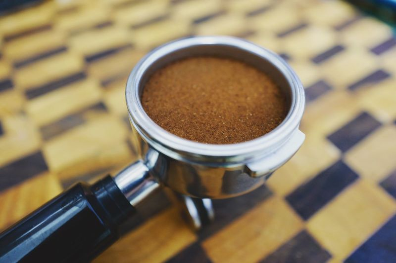 Close-Up Of Coffee In Porta Filter On Table