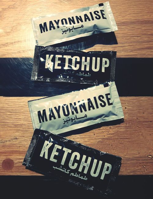 Ketchup Mayonaise Word Art Western Script Arabic Script Caligraphy Black And White Condiments  Indoors  Desk Wood - Material No People Close-up Khobar Saudi Arabia