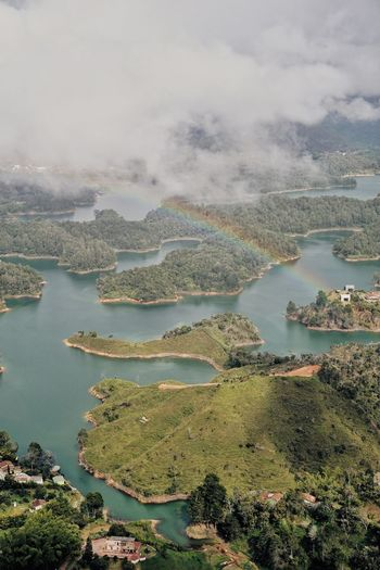 Guatape Colombia 2 Guatapé Reservoir Colombia Swinginginaplumtree Rainbow🌈 Rainbow View From Above Viewfromabove View Water Nature Beauty In Nature Scenics No People Sky Lake Outdoors Tranquility Day Aerial View Tree Landscape Mountain