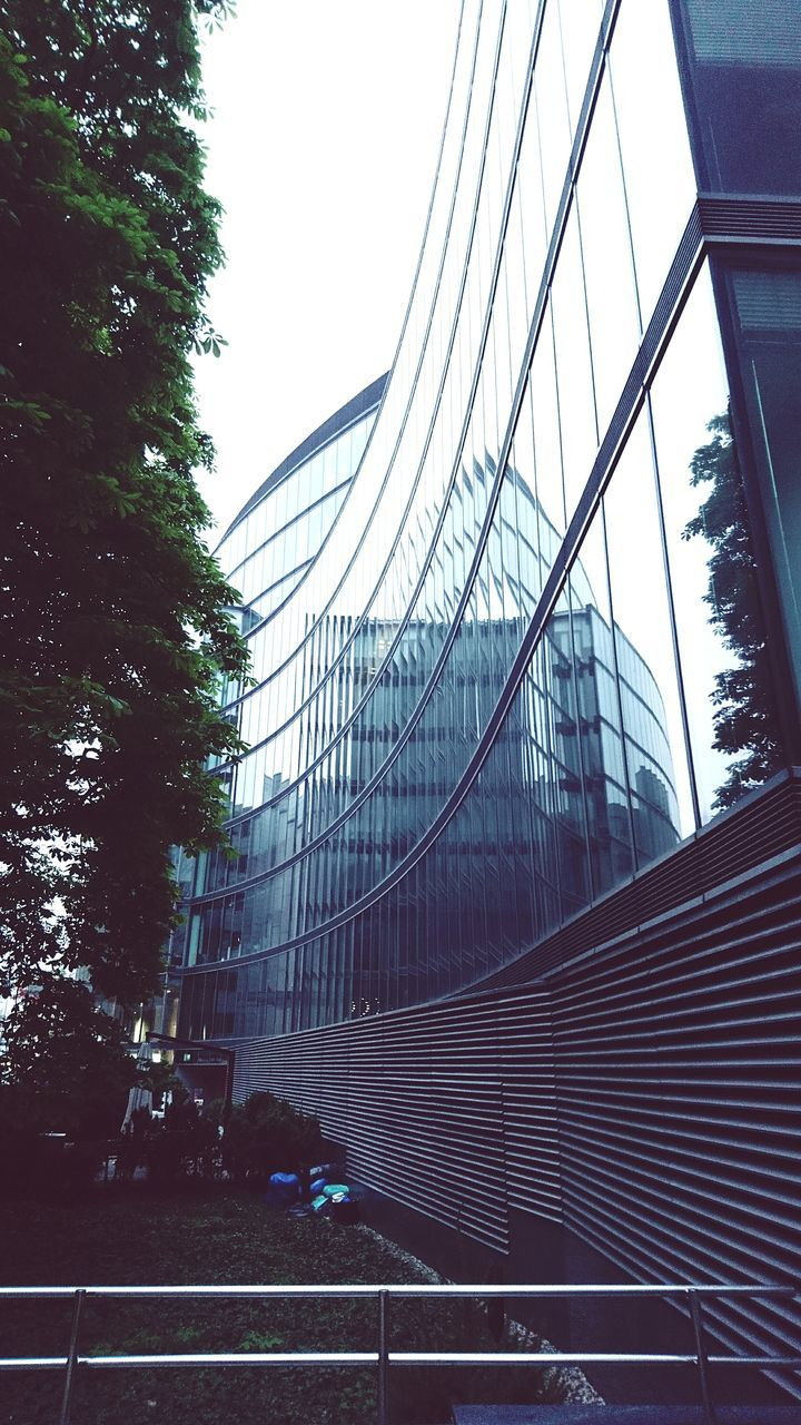 architecture, built structure, modern, tree, building exterior, no people, day, road, outdoors, sky, city, skyscraper