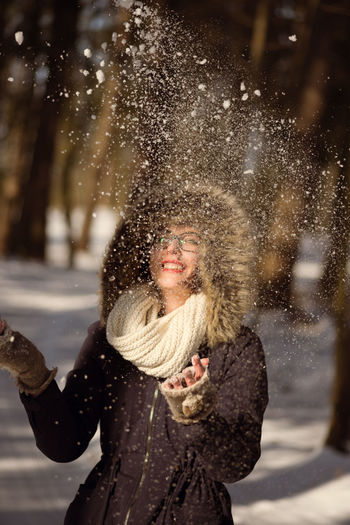 Adult Beautiful Woman Cheerful Cold Temperature Day Enjoyment Fun Happiness Leisure Activity Lifestyles Motion Nature One Person One Woman Only Only Women Outdoors Smiling Snow Snowflake Snowing Warm Clothing Winter Women Young Adult Young Women