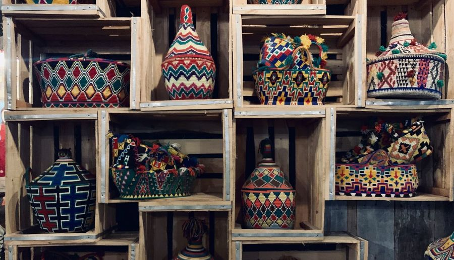 Close-up of multi colored containers on shelves