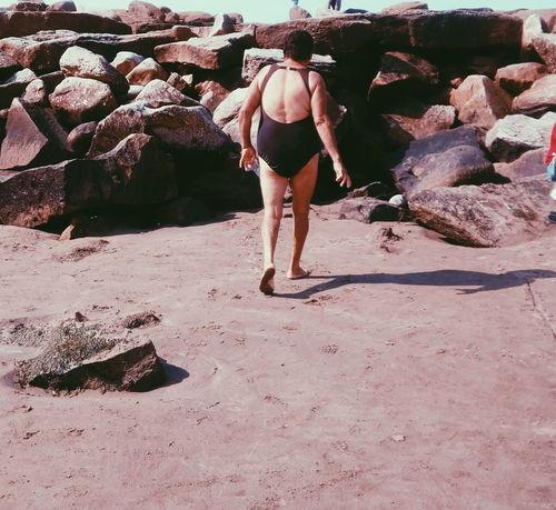 On the rocks Mum Buenosaires Playa Mardelplata Travel Mardel Mytravelgram VSCO #photography People EyeEm Selects Travel Destinations Sand Summer Beach Sand Dune Young Women Women Walking Low Section Summer Exploratorium