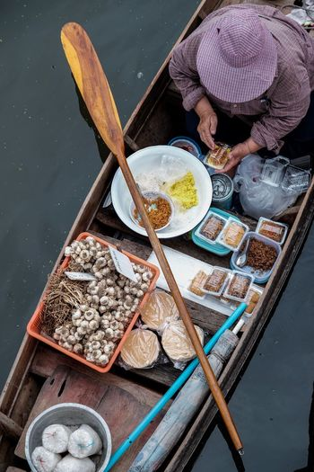 High Angle View Of Man Selling Food At Floating Market