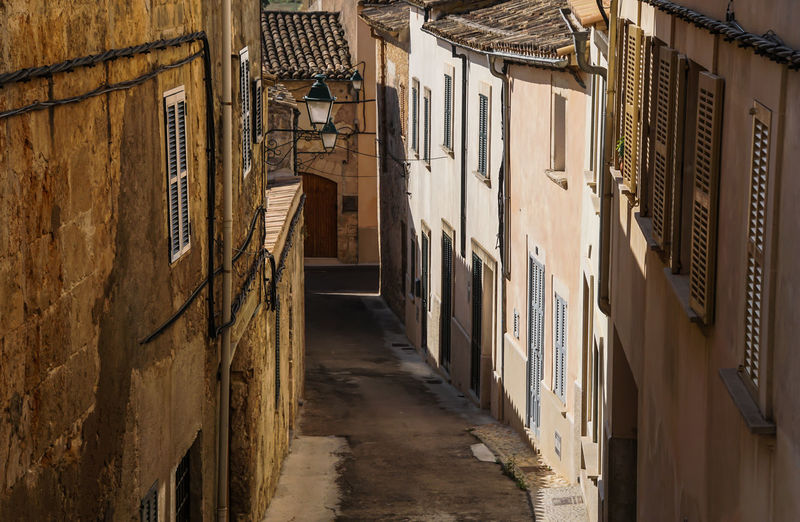 Alley Architecture City Diminishing Perspective Empty Mallorca No People Old Buildings Residential Building Residential District Residential Structure Road SPAIN Spanien Street The Way Forward Town Townhouse Traveling Urban Urlaub Vacation Walkway