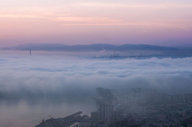 Hidden under the fog Aerial View Architecture Atmosphere Atmospheric Mood Beauty In Nature City Cloud Cloud - Sky Cloudscape Development Fog Idyllic Majestic Mountain Mountain Range Nature Scenics Sky Sunset Surrounding Tranquil Scene Tranquility Travel Destinations Wide Wide Shot