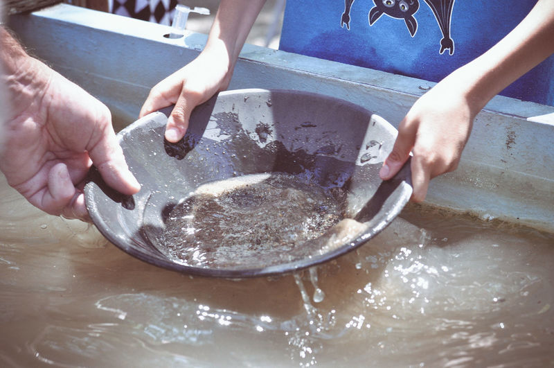 Calm Close-up Gold Country History Holding Human Hand Occupation Panning For Gold People Real People Table Water Working