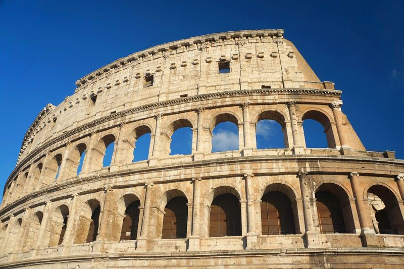 Roman Colosseum on sunny day Rome Amphitheater Ancient Ancient History Arch Archaeology Architecture Building Exterior Built Structure History Italy Low Angle View No People Old Ruin Roman Civilization Sky The Past Tourism Travel Travel Destinations