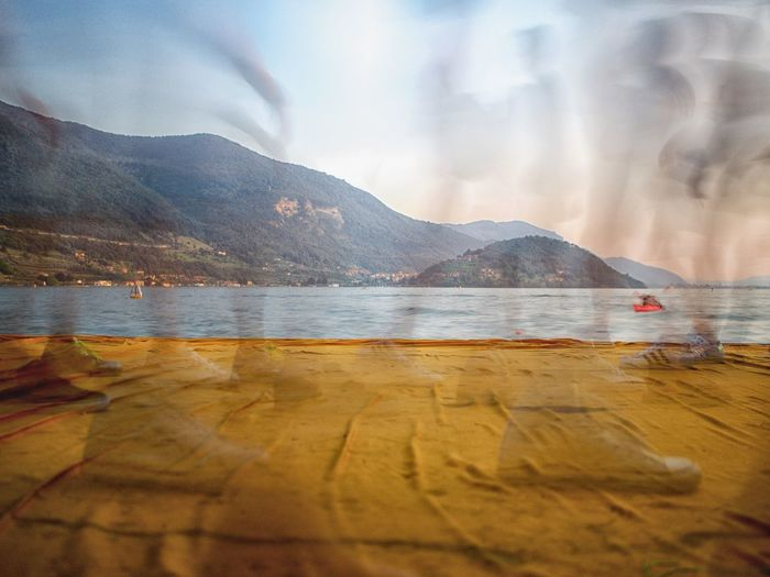 Floating On Water Floating Piers Iseo Lake Italy Brescia 2016 Christo Sulzano Mountain Water Sky Beauty In Nature Day Nature Scenics - Nature Reflection Outdoors Cloud - Sky Tranquility Tranquil Scene Sea Non-urban Scene No People Selective Focus Idyllic