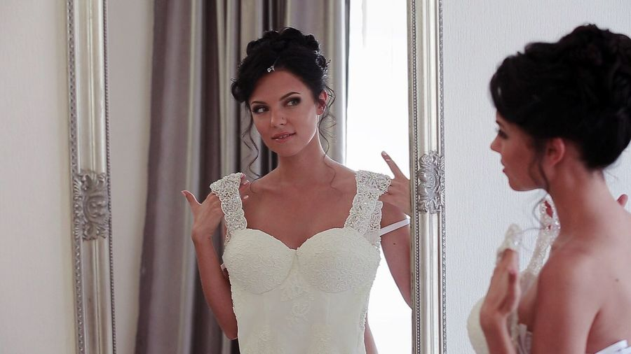 Waist Up Only Women Adults Only Young Adult Young Women Beautiful Woman Beauty Curtain Indoors  Fitting Room People Adult Wedding Dress Bride One Person Day Admiring The View Admire Wedding Wedding Photography Bridetobe White Dress Bride Dress Hairstyle Reflection