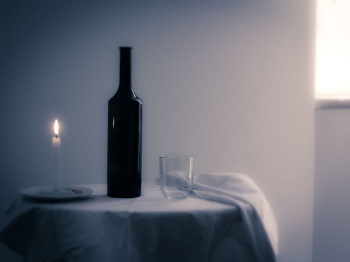 Still life Flames Bottle Candle Candle Light Close-up Flame Food And Drinks Glass Indoors  No People Still Life Table Wineglass