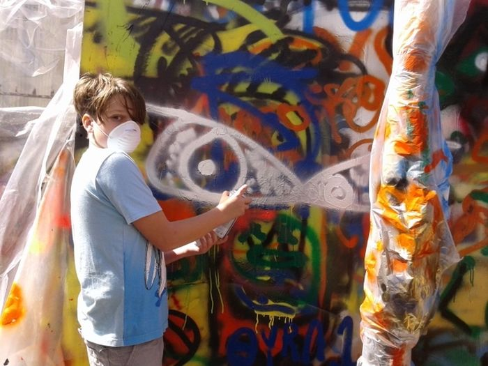 Safety Mask Graffiti Boy Vandal Boys Boys Painting Boys Will Be Boys Casual Clothing Close-up Day Focus On Foreground Garffiti Artist Graffiti Art Boys Handsome Boy Graffiti Artist Lifestyles Multi Colored Paint Spraying Spraying Graffiti Young Graffiti Artist