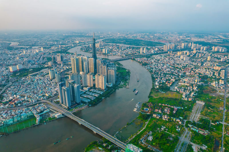 High angle view of river amidst buildings in city