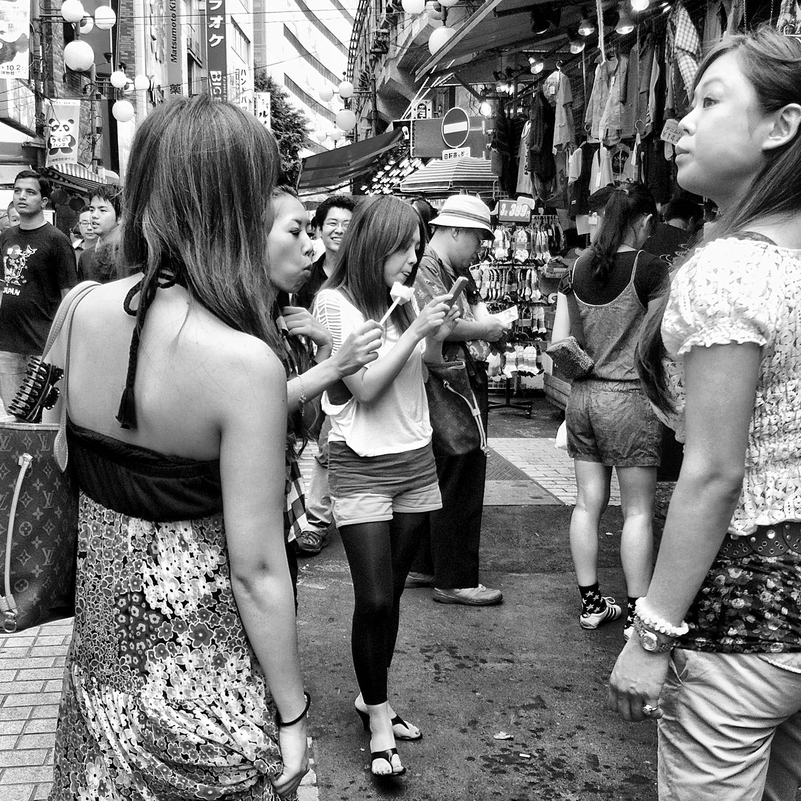 lifestyles, togetherness, leisure activity, casual clothing, bonding, childhood, girls, person, full length, love, friendship, family, boys, street, city, sitting, men