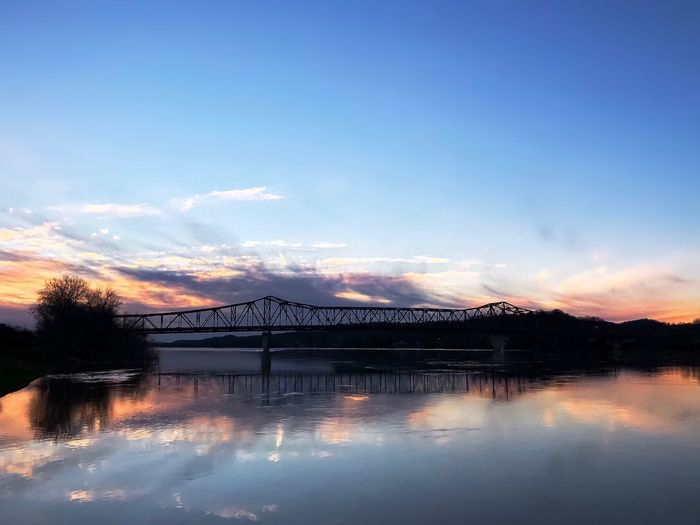 Enjoy the beauty of a sunset. It's natures farewell kiss for the night. Eyeem Friends Tadaa Community Sky Sunset Water Cloud - Sky Reflection Bridge - Man Made Structure Architecture Outdoors Beauty In Nature No People Built Structure Nature Blue