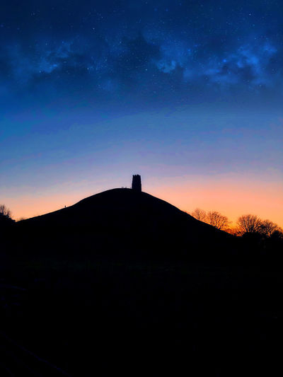 Glastonbury Tor Architecture Astronomy Beauty In Nature Day Landscape Mountain Nature No People Outdoors Scenics Silhouette Sky Star - Space Sunset Tranquil Scene Tranquility