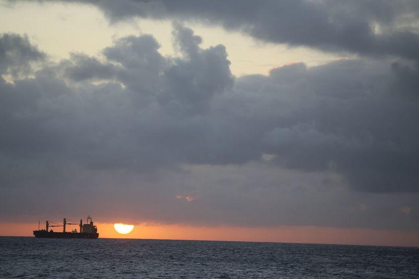 Beach Beauty In Nature Caribbean Sea Cloud - Sky Cloud Covered Sun Dramatic Sky Outdoors Scenics Sea Sky Storm Cloud Sunset Vessel Water