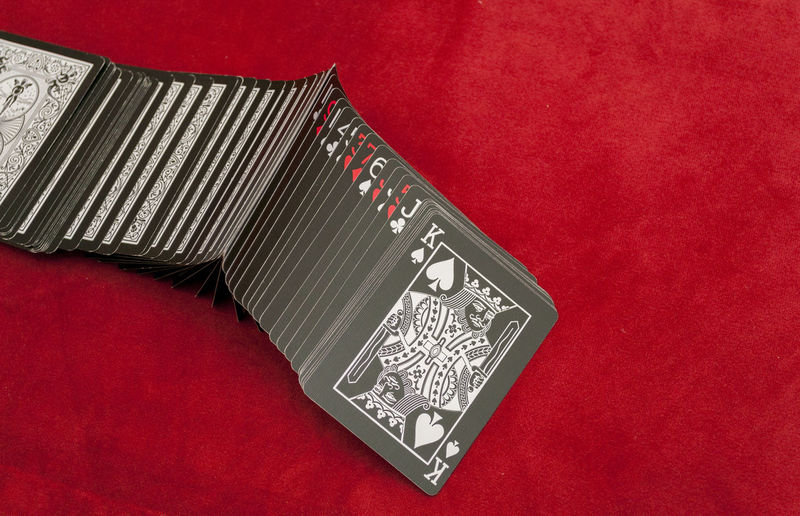 Black Deck Of Playing Cards Spread Out On Table Cards Close-up Deck Gambling Game King Magic No People Playing Cards Poker Red Shuffle Trick