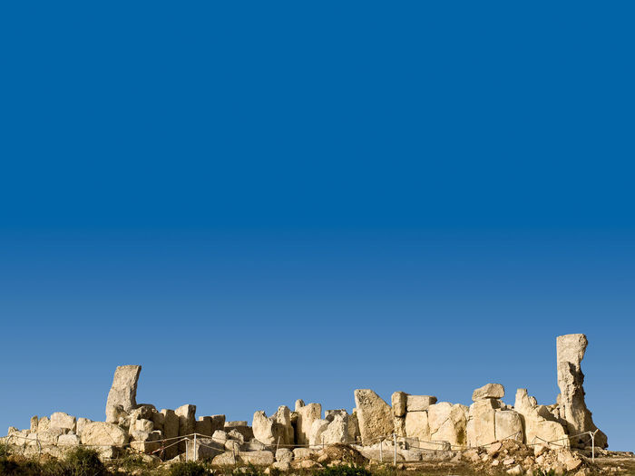 Hagar Qim Megalithic Temples Hagar Qim Hagar Qim Prehistoric Site, Malta Ancient Ancient Civilization Arid Climate Beauty In Nature Blue Clear Sky Copy Space Day Low Angle View Megalith Megalithic Nature No People Outdoors Prehistoric Prehistoric Life Rock - Object Sky