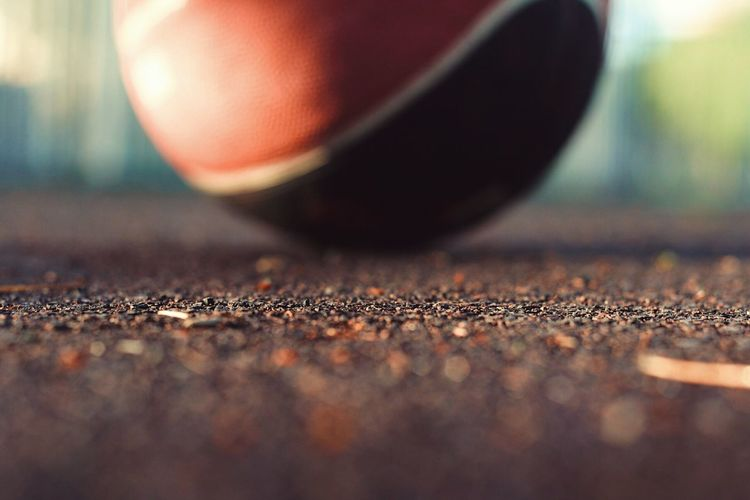 Basketball Selective Focus Close-up No People Day Still Life Wood - Material Nature Rough Solid Sport Table Single Object Outdoors Stone - Object Sunlight Surface Level Freshness Sand Focus On Foreground
