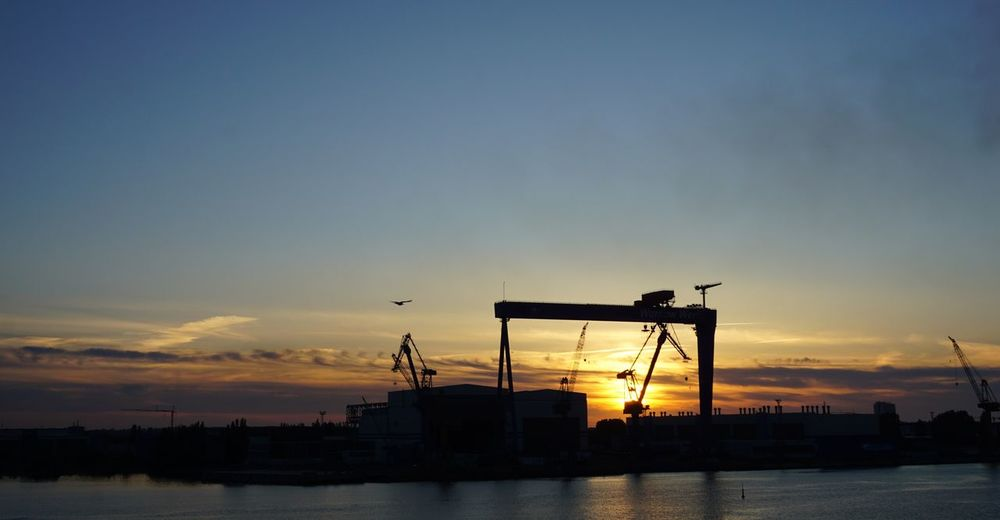 No Edit/no Filter Sunset Sky Water Architecture Silhouette Machinery Industry Crane - Construction Machinery Built Structure Cloud - Sky Nature Sea Commercial Dock No People Pier Freight Transportation Outdoors Beauty In Nature Copy Space Construction Equipment