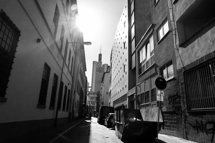 Building Exterior Built Structure Architecture City Building Sunlight Sky The Way Forward Narrow City Life Shadow Outdoors Transportation Real People Incidental People Direction Residential District Day Street