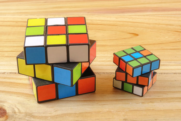 RUBIK'S CUBE , CREATIVITY TOY Creativity Rubik Cube Block Choice Close-up Complexity Creativity Cube Shape Design Flooring Geometric Shape Indoors  Intelligence Large Group Of Objects Multi Colored No People Puzzle  Rubik Shape Still Life Table Toy Toy Block Variation Wood - Material