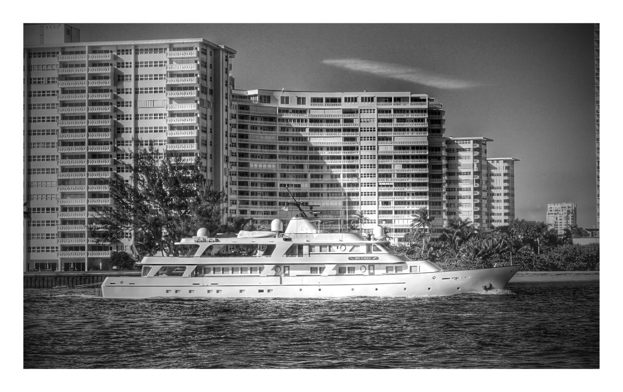 architecture, building exterior, built structure, water, waterfront, nautical vessel, outdoors, tree, modern, no people, city, day, sea, skyscraper, sky, yacht, nature