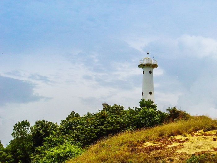 Sky Tree Lighthouse Day Cloud - Sky Outdoors Tranquility Travel Destinations No People Nature Water Architecture Scenics Building Exterior Lanta Yai Island Lanta Nationalpark Sand Island Grass Vacations Landscape Koh Lanta Krabi Thailand