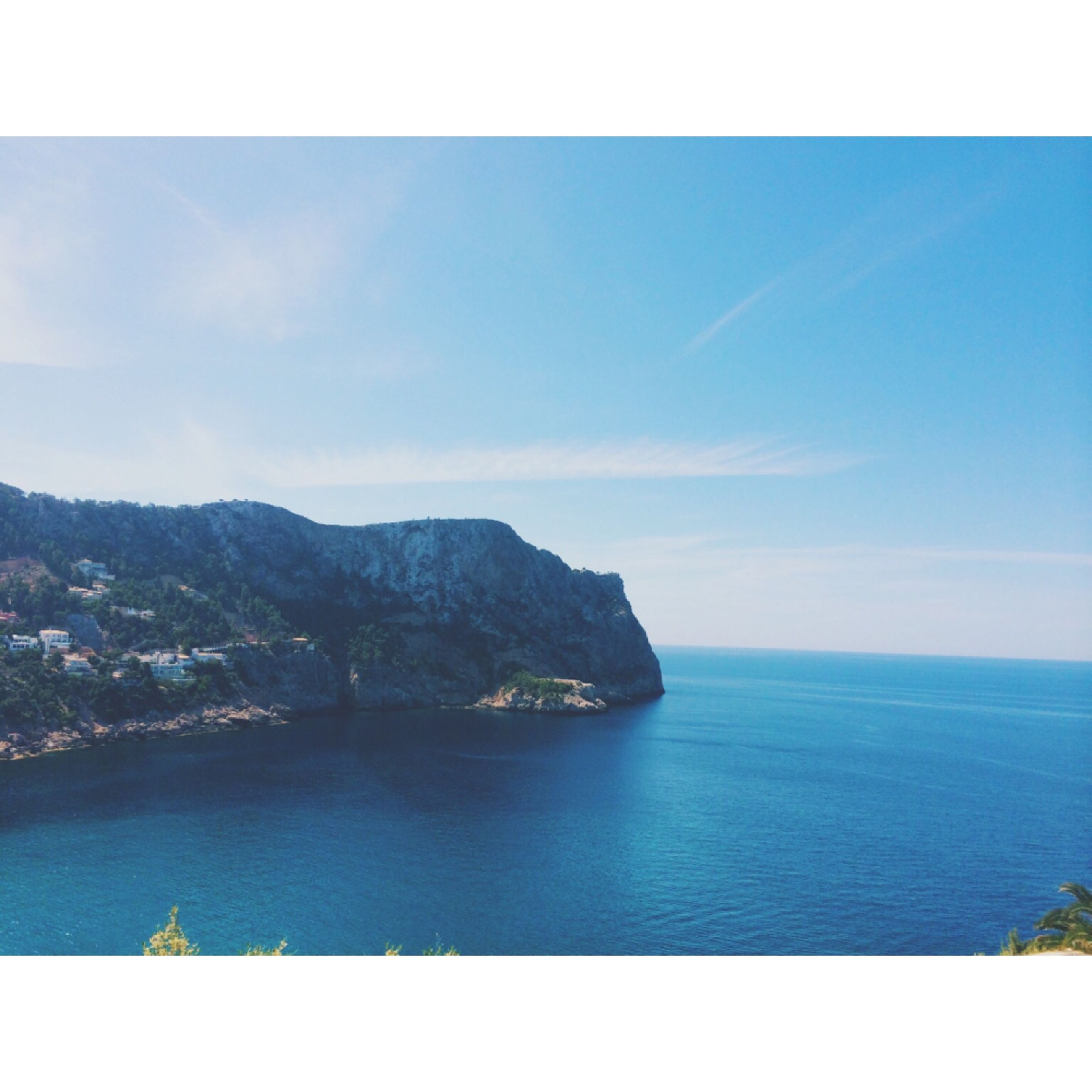 transfer print, water, sea, auto post production filter, tranquil scene, scenics, tranquility, sky, beauty in nature, blue, mountain, horizon over water, nature, waterfront, idyllic, coastline, outdoors, mountain range, ocean, day