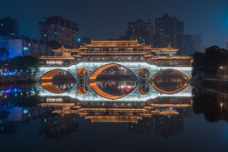 restaurant on top of a bridge Architecture Building Exterior Reflection City Built Structure Water Illuminated Night Waterfront River Building No People Nature Outdoors Sky Cityscape Transportation Connection Bridge Mode Of Transportation Arch Bridge Wallpaper Wallpaper Background