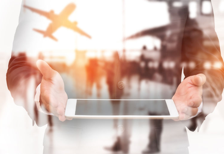 Screen Suit Tablet Tourist Transportation Airplane Doble Exposure Hand Holding Human Body Part Internet Passenger Craft People Technology Terminal Travel Destinations